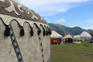 Close up of yurt in field by mountains